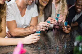 Group of friends having shots