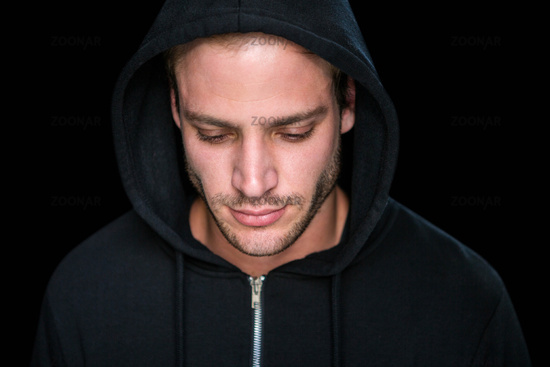 Handsome man wearing a black hoodie