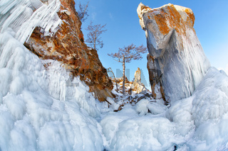 Rocks covered by icicles on winter siberian Baikail lake