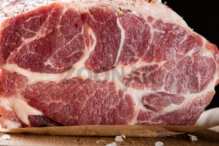 Close up photo of raw meat. Pork neck with herbs