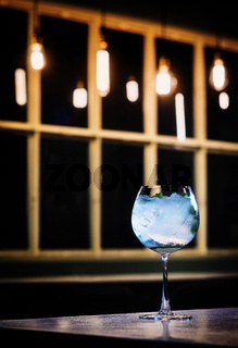 blue curacao and vodka cocktail drink in trendy bar