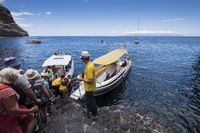 Walkers boarding boats for the trip to Los Gigantes after completing the walk down the Masca barranco