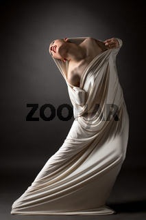 Concept. Beautiful naked girl breaks her cocoon