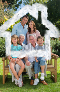 Composite image of smiling multi generation family sitting on bench in park