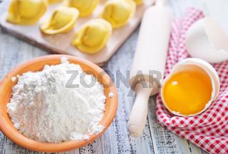 flour and raw pelmeni