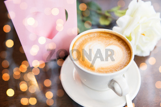 close up of greeting card with heart and coffee