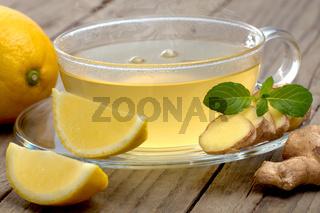 Ginger lemon tea on wooden table