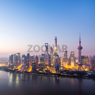 waterfront cityscape in blue sky at dawn