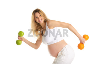 Pregnant woman involved in fitness dumbbells