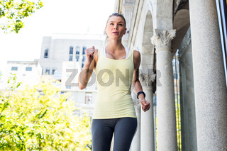 A beautiful woman running in the street