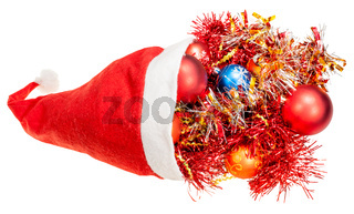 red santa hat with xmas balls and decorations