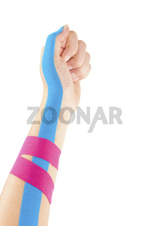 Kinesio tape on female hand.
