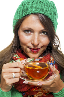 Attractive woman warming up with a cup of hot tea