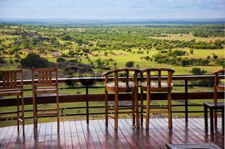 Chairs on terrace. Savanna landscape in Serengeti, Tanzania, Africa