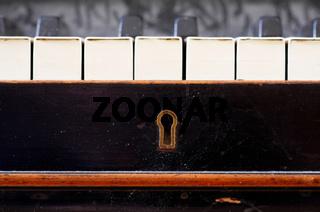 Old piano keys close up