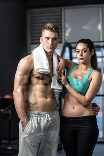 Fit couple posing in front of the camera