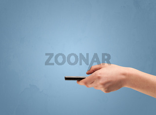 Holding telephone device from profile