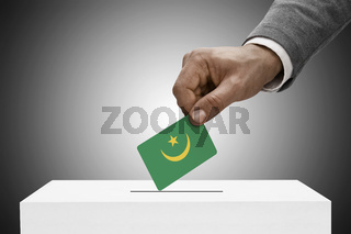 Black male holding flag. Voting concept - Mauritania