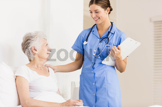 Doctor taking care of suffering senior patient