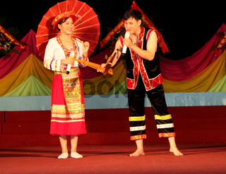pairs of boy and girl in traditional costume attend cultural festivals
