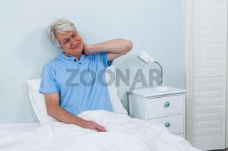 Senior man suffering from neck pain