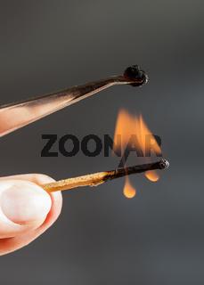 match flame ignites silk tissue sample
