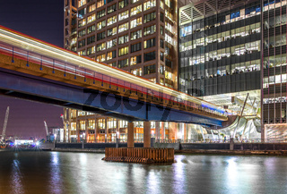 DLR train at Hweron Quays Station Canary Wharf at night, London, United Kingdom