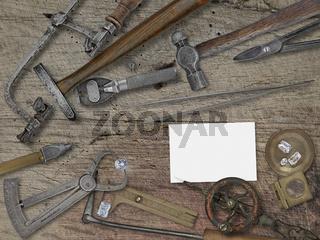 vintage jeweler tools over wooden bench