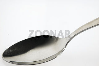Spoon on the white table.