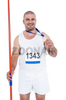Athlete with olympic gold medal holding javelin