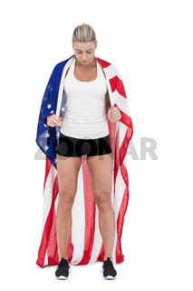 Female athlete holding American flag