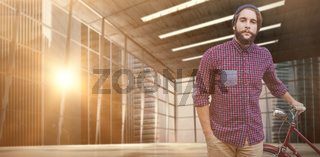 Composite image of portrait of confident hipster with bicycle