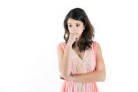 Portrait of a thoughtful young woman in a pink dress
