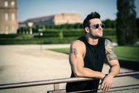 Muscular man in luxurious garden in Venaria, Italy