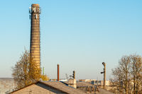 Chimney over urban roofs