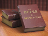 Rules an regulations books with official instructions and directions of organization or team.
