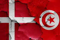 flags of Denmark and Tunisia painted on cracked wall