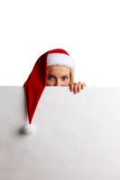 Christmas woman peeking over white billboard