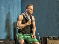 Handsome muscular man posing in gym