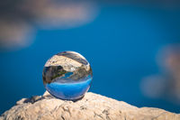 Kotor Bay reflected on a glass ball