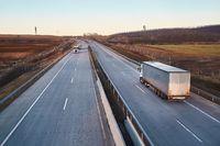 Highway with cargo trucks