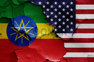 flags of Ethiopia and USA painted on cracked wall