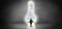 Businessman standing in a big keyhole