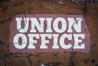 Grungy Workers Union Office Sign