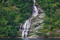 Beautiful waterfall Geiranger fjord.