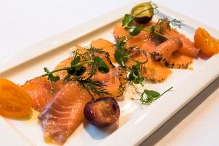 A plate of gravlax, scandinavian cured salmon.