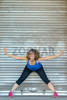 Happy healthy fit woman exercising in town