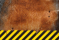 Rusty metal background with grunge hazard sign
