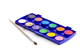 Watercolor pallet with brush.