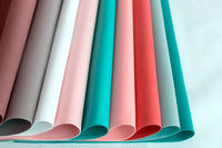 Sheets of soft paper of different colors